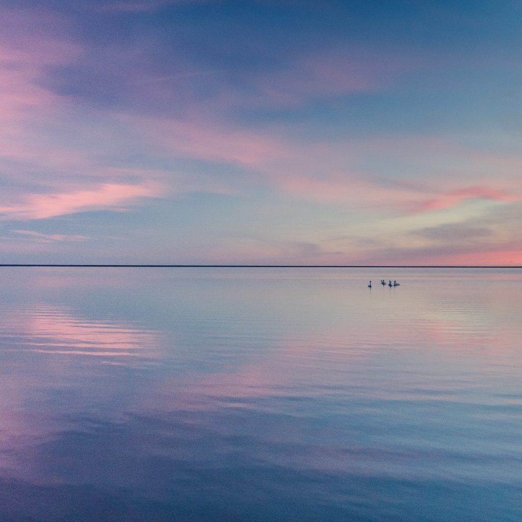 beautiful sunset over calm cold lake